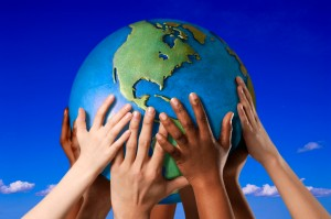 Hands on a globe, © Royalty-Free/Corbis