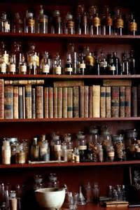 Alchemist book and bottles on shelf